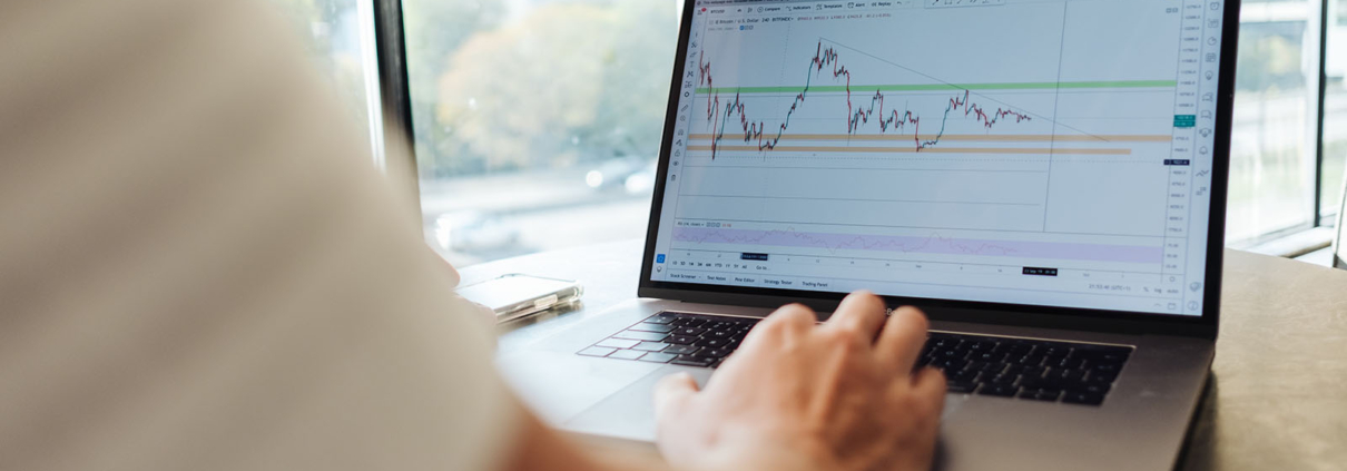 Laptop showing trading chart on screen